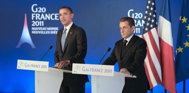 Prezydent USA Barack Obamia i prezydent Francji Nocolas Sarkozy na szczycie G20 w Cannes. fot. EPA/LIONEL BONAVENTURE